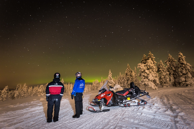 Snowmobile northern ligths